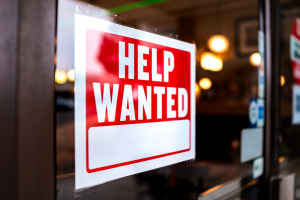 Help-wanted-sign-on-store-window-vf